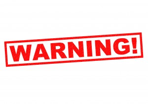 WARNING! red Rubber Stamp over a white background.