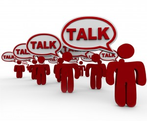 Talk word in speech bubbles on red 3d people to illustrate communicating or sharing a message or information in a crowd or social group or connected network, forum or class